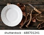 an empty white plate with stag... | Shutterstock . vector #688701241