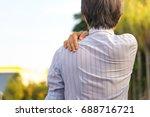 young man having shoulder pain. ... | Shutterstock . vector #688716721