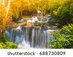 waterfall in green forest on... | Shutterstock . vector #688730809