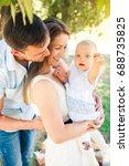 happy young caucasian family... | Shutterstock . vector #688735825
