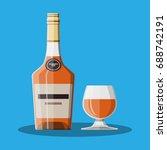 cognac bottle and glass. cognac ... | Shutterstock . vector #688742191