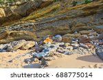 the rocky coast seen in... | Shutterstock . vector #688775014