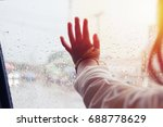 hand of little girl looking out ... | Shutterstock . vector #688778629