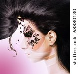 flower woman with creative hair and face art with rhinestone on pink rose background - stock photo