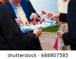 wedding guests eating an... | Shutterstock . vector #688807585