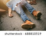 Small photo of Emergency First Aid on A Man has an Accident and Lose Consciousness on the Road , One Part of the Process Resuscitation