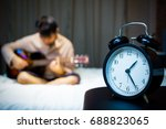 asian man playing guitar in bed ... | Shutterstock . vector #688823065