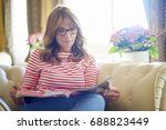 shot of a relaxed middle aged... | Shutterstock . vector #688823449