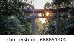 Stock photo sunlight shining through torii wooden gate of meiji shrine meiji jingu the most famous shinto 688891405