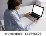 a man working on a laptop and a ... | Shutterstock . vector #688946809