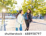 best friends walking together... | Shutterstock . vector #688958797