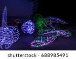 lights show on the beach... | Shutterstock . vector #688985491