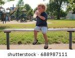a child drinking milk on a...   Shutterstock . vector #688987111