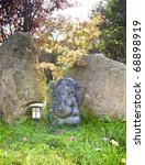 Indian ganesh figure, photographed in the garden of an ayurveda and yoga center. - stock photo