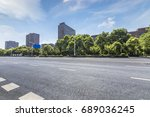 empty road with modern business ... | Shutterstock . vector #689036245