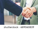 businessman shaking hands with...   Shutterstock . vector #689060839