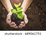 close up human hands holding a... | Shutterstock . vector #689061751