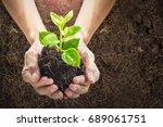 close up human hands holding a... | Shutterstock . vector #689061751