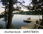 two muskoka chairs on a wooden... | Shutterstock . vector #689078854