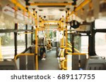Small photo of Public transportation. Blur image of interior of modern city bus