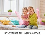 two cute children baby girls... | Shutterstock . vector #689132935