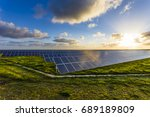 solar panels at sunrise with... | Shutterstock . vector #689189809