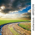 rural way under dramatic sky - stock photo