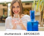 young woman with water  | Shutterstock . vector #689208235