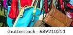 Small photo of fast fashion women bags and purses on display at flea market or thrift store to resale, reuse, recycle, donate or exchange outdoor