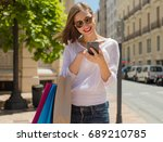 young woman with mobile phone... | Shutterstock . vector #689210785