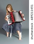 Small photo of Girl accordionist playing an Accordion