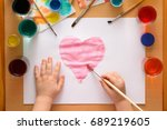 a child draws a pink heart on a ... | Shutterstock . vector #689219605