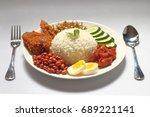 nasi lemak is a rice dish... | Shutterstock . vector #689221141