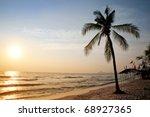 Sunrise on the beach. - stock photo