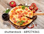 photo of a hot pizza on wooden... | Shutterstock . vector #689274361