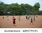 Small photo of AUROVILLE, INDIA - April 2017: Children playing in Certitude sports ground