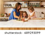 little sisters cooking with her ... | Shutterstock . vector #689293099
