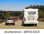 camper and car on the road in...