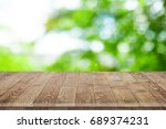 empty wooden table for product... | Shutterstock . vector #689374231