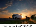 truck transportation at sunset | Shutterstock . vector #689430169