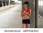 female runner  relaxing after... | Shutterstock . vector #689436361