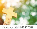 stone cross on nature green... | Shutterstock . vector #689502604