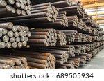 rows of steel round bar storage ... | Shutterstock . vector #689505934