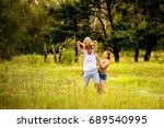 family with child walking... | Shutterstock . vector #689540995