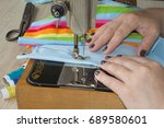 Small photo of Sewing Process , the sewing machine sew women's hands sewing machine. sewing machine and female scissors