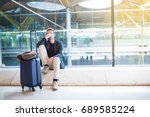 man upset at the airport his... | Shutterstock . vector #689585224