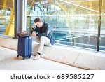man upset at the airport his... | Shutterstock . vector #689585227