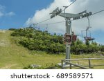 ski lift taking tourists on top ... | Shutterstock . vector #689589571