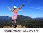 woman on the rock. beautiful... | Shutterstock . vector #689599579
