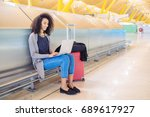 attractive woman at the airport ... | Shutterstock . vector #689617927